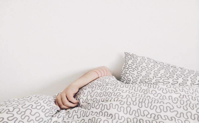 Woman asleep under the duvet