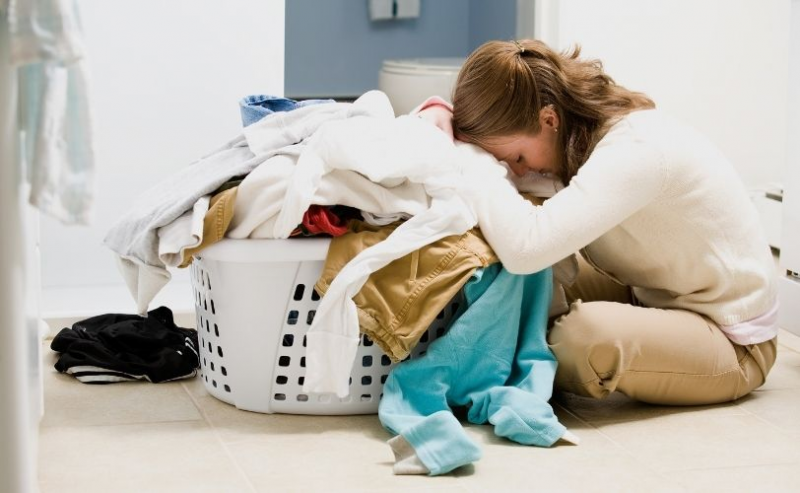 Woman overwhelmed with laundry