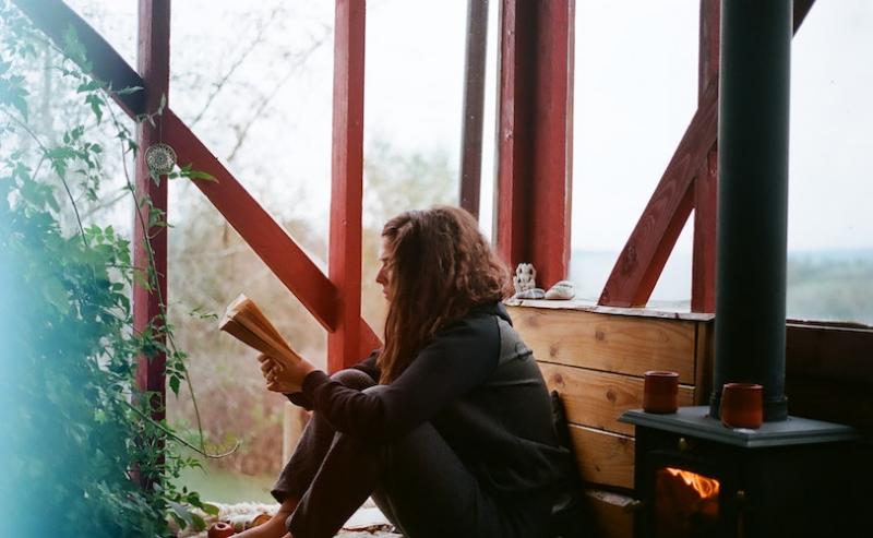 Woman sitting on floor reading