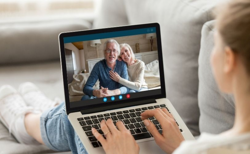 Girl video calling grandparents