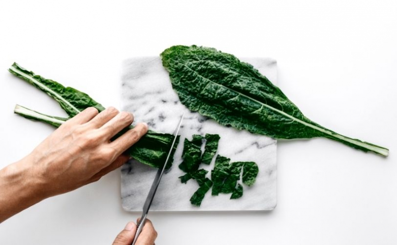 Man chopping kale